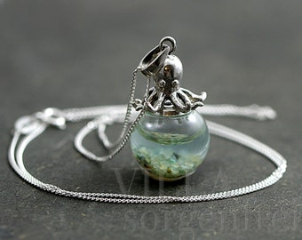 Sterling octopus seawater necklace. 925 sterling octopus carrying glass orb filled with seawater and tiny pebbles. Sterling necklace.