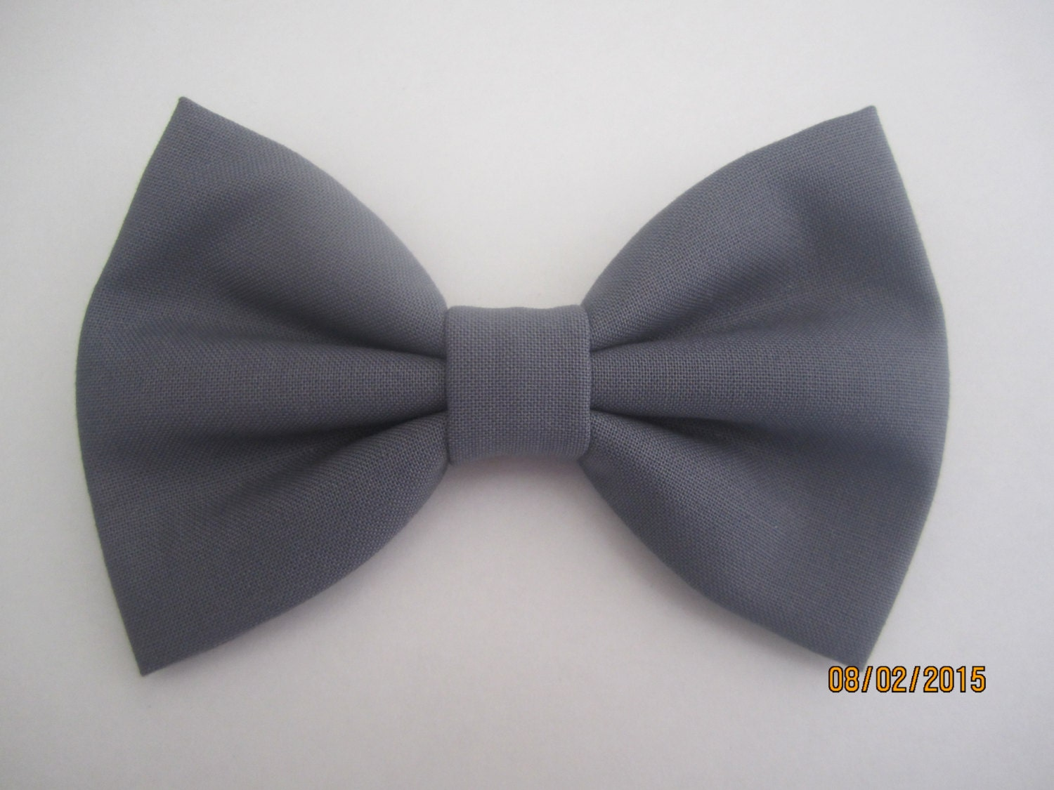 Suspender and Bow Tie Matching Colors. Pre-tied band style with a clip BowTie. for a great accessory to a tuxedo or a suit. A great formal classical style bow tie with a clip.