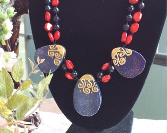 Two strand beaded coral necklace with three center lapiz teardrops