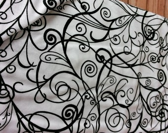 Moda 32350 11, white background with swirls of black design