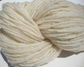 hand-spun, single-ply, un-dyed wool yarn