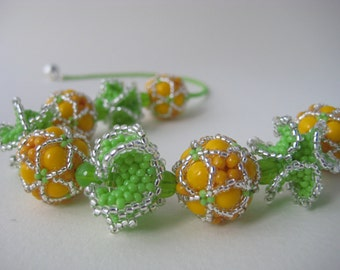 Summery beaded bead necklace in orange, lime green and silver