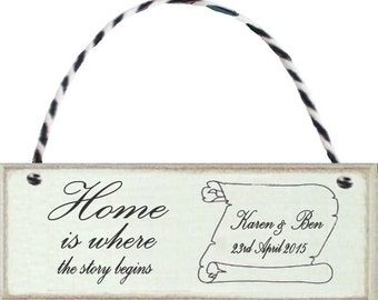 """A personalised """" Home is where the story begins"""" hanging gift sign.  A keepsake for ever.  Weddings, Housewarming, Family and Friends."""
