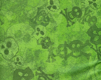 Skulls on green background, Batik fabric- sold by the yard