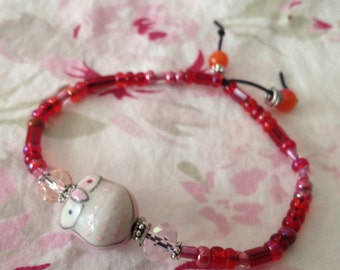Whimsical Pink Owl and Red Glass Bead Stretch Bracelet