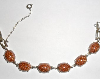 Pretty vintage goldtone link bracelet with oval goldstone insets and safety chain