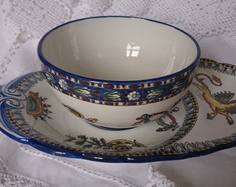 Gien tennis/hostess cup and plate. Made in the Loire valley. Twentieth century version of Renaissance majollica patterns.