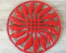 Red cast iron French trivet