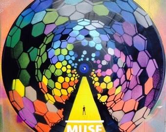 Artistic version of Muse vinyl record spray paint stencil handmade clock