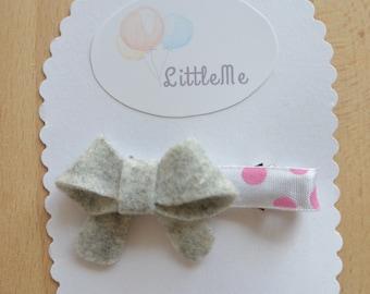 Little grey bow hair clip.