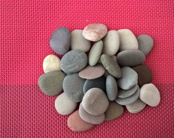 Set of 30 small beach pebbles.