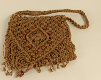 70's Vintage Brown Macrame Woman's Handbag with wooden button accents.
