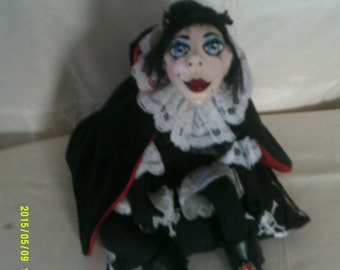 Salem.individually sculpted art doll.Paperclay head,painted in acrylics,cloth body
