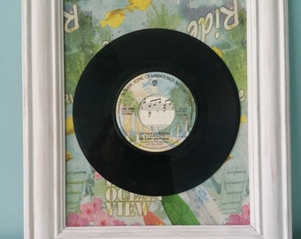 Vinyl record framed with lovely decoupaged background
