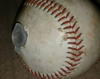 Baseball geocaching container, staple for many geocache hides