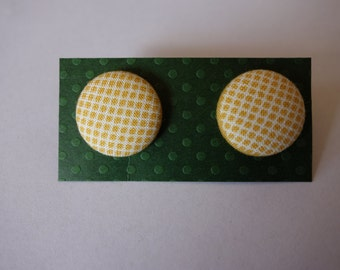 Handmade yellow cross-stitch print fabric button earrings. Hypo-allergenic nickel-free studs