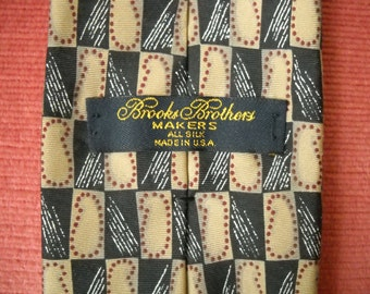 10% off.  BROOKS BROTHERS Vintage Men's tie. Silk. Rectangle design in red/cream/black. Made in U.S.A.