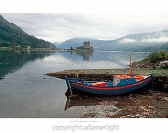 Eilean Donan Castle with vintage boat