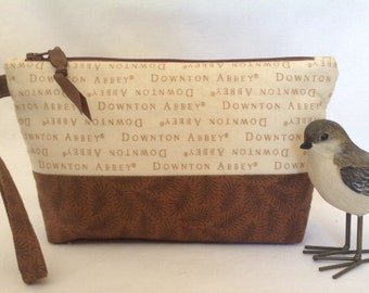 A Cute Downton Abbey Zippered Pouch with Wrist Strap