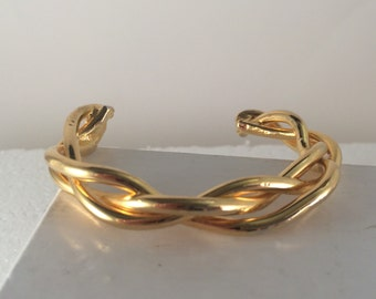 Gold plated brass braided bangle bracelet.