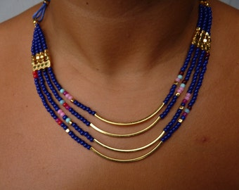 Blue beaded multi strand necklace with gold plated brass.