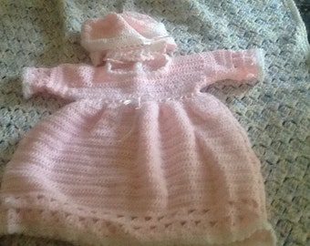 Crocheted baby's dress and bonnet
