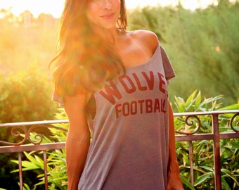 YOUR TEAM Custom Off the Shoulder Flutter Sleeve Flowy Muscle Tee.  Six Tee Colors to Choose From, all made in the USA.