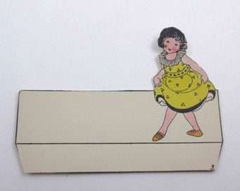 Vintage Unused Die Cut Art Deco Place Card with Cute Little Girl in Yellow and Black Dress