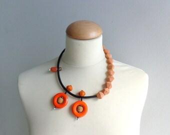 Orange asymmetric statement necklace