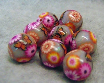 foiled polymer clay beads with flowers and butterfly