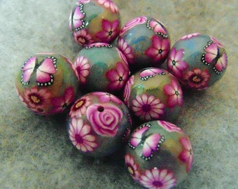 round foiled polymer clay beads with flowers and butterfly