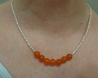 Orange bead and small pearl necklace