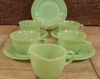 Vintage Jadeite lot- 4 cups and saucers, 1 small plate and 1 creamer- most are Jane Ray Fire King design