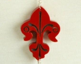 Bakelite Pendant flur de lis pendant , sold by each