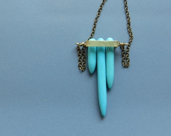 small brass frame with turquoise points long necklace