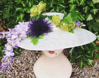 Mint green sinamay hat with wisteria, silk roses and other flowers wedding garden party