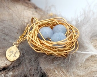 Personalized bird nest necklace with three aquamarine eggs and initial charm- gold plated woven wire- March birthstone- crystal healing