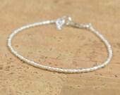 Super tiny white pearls bracelet