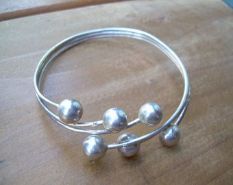 Beautiful Vintage 925 sterling silver cuff style bracelet with ornate bead balls on end of stems. Unique