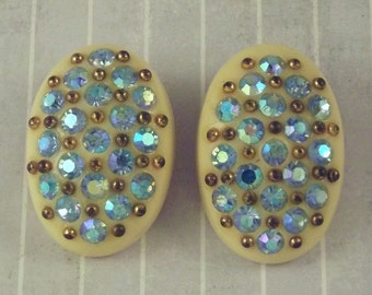 Vintage Celluloid Oval Clip On Earrings Cream Colored Blue Aurora Rhinestones Gold Tone Studs Off White