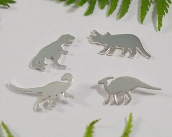 Silver Dinosaur earrings: A set of 4 of Dinosaur shaped sterling silver earrings.