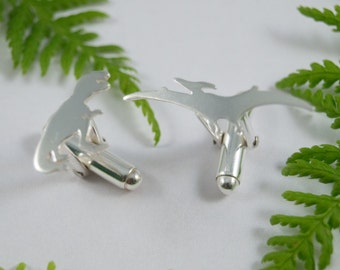 Silver Dinosaur cufflinks: A pair of T Rex and Pterodactyl sterling silver cufflinks.