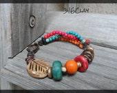 Beaded Bracelet Miulti strand beaded bracelet  tribal mask red orange turquoise