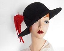 Vintage fedora hat, black tilt with red feathers