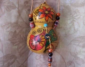 Gourd medicine bag necklace flowers and paisleys. 1842.