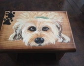 Your Pooch on a Stool.  A delightful addition that can go anywhere in your home. A hand painted picture of your best friend on a foot stool.
