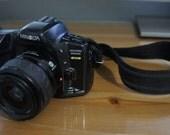 Minolta MAXXUM 450si date 35mm film camera with Minolta 35-80mm 1:4-5.6 telephoto Power zoom lens.