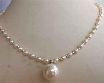 Pearl Necklace- 18inch cultured 3-4mm white pearl necklace & 14mm shell pearl pendant