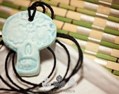 Robin Egg Blue Sugar Skull Day of the Dead Style 1 Essential Oil Diffuser Necklace   Lisa C. Warren   Aromatherapy Natural Medicine