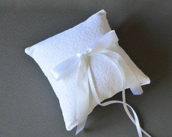 White lace wedding ring pillow with white satin ribbon bow